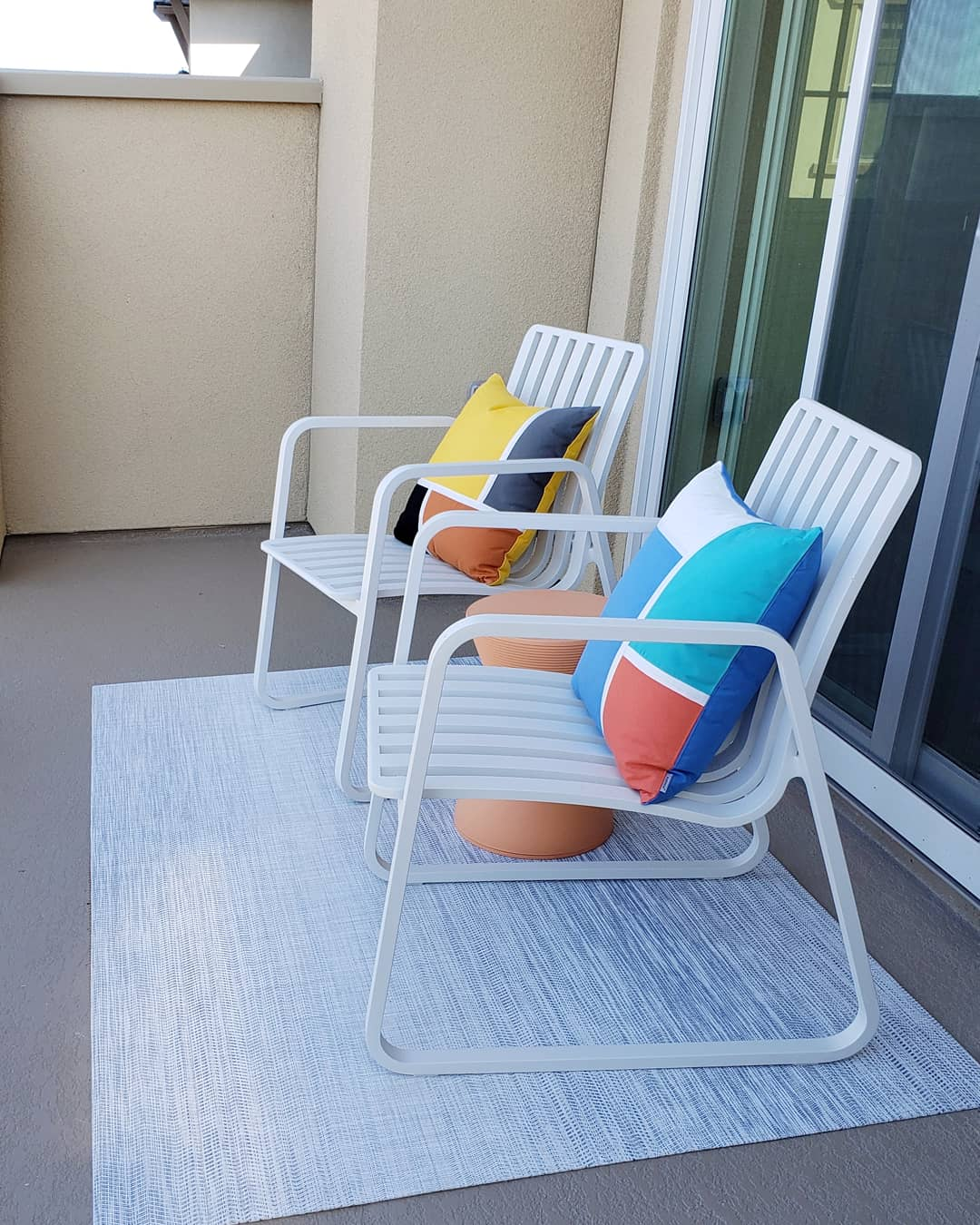Easy maintenance outdoor chairs outside master bedroom